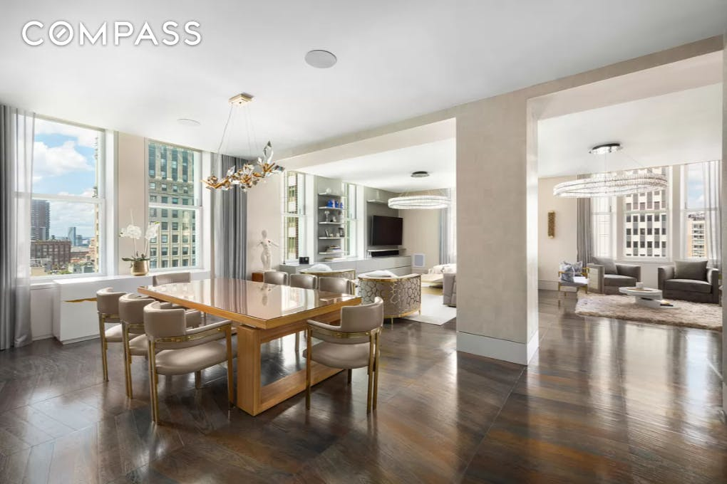 The first and most incredible high floor resale offering at 49 Chambers Street. This E-F combination is nearly 4,000 square feet with 4 large bedrooms + a study and is the only available such combination in the building. #14EF is a rare opportunity to purchase a grand, new, fully outfitted Tribeca home with the highest level of customization. The current owner has spent well over one million dollars meticulously upgrading the residence with custom Savant smart home, Lutron lighting, Ornare closets and cabinetry, sound, and decorative upgrades that all will transfer to a lucky new owner.  A completely optimized custom floor plan separates this residence from the rest, and the two combined apartments were specifically chosen and meticulously designed by the current owner for the scale, exposure, and flow. Boasting three exposures, high ceilings, and perched on one of the highest floors of 49 Chambers Street, there is consistent light and views throughout.  Enter into #14EF's proper entry foyer and you are immediately struck by the depth and scale of the home. The grand and open plan corner living/dining space stretches over fifty feet in depth and enjoys large corner windows with northwest exposures, perfect to catch the sunset and evening light over Tribeca. The open kitchen has an extraordinary amount of storage, a waterfall honed San Marino marble island, and top-of-the-line chef's appliances from Sub-Zero, Gaggenau and Miele. There are custom lighting upgrades and motorized shades throughout this area and ample wall space to display an art collection.  Beyond this grand room is an expansive corner home office, library or second master bedroom, separated off of the living area with custom double doors. It has its own five-piece master bath and has been fully upgraded with custom closets, sound, shades and lighting.  In the bedroom wing of the residence, there is an additional study or home office, currently cleverly designed with a custom Murphy bed to serve as an 