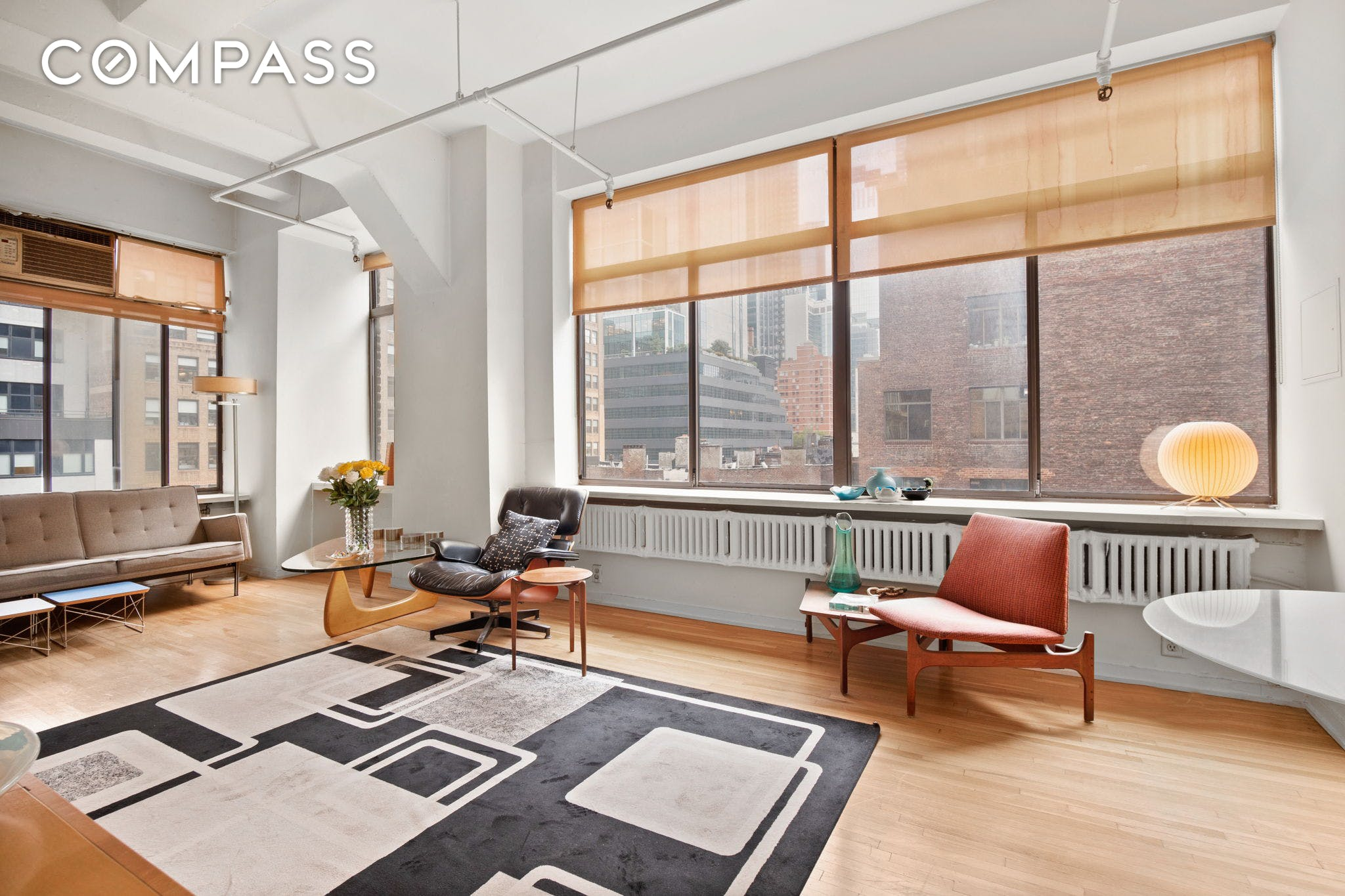 By Appointment ONLY Request a showing: 1pm to 6pm with 24 hour notice.  GREAT BONES. This ideally sized CORNER LOFT is a dream come true with South and West views and dazzling light through walls of oversized windows. This 11-foot ceiling open LOFT has a grand living/entertainment room with an intimate BALCONY for stepping out. The spacious kitchen and bath are in fine original condition perhaps READY FOR A FACELIFT; the big, windowed cook's kitchen has infinite possibilities, and the windowed dual entry ensuite bath is a sought-after feature. A very quiet large bedroom is fitted with California closets (one is double-width). There is room to spare for a washer/dryer.  Envision this rare find authentic loft as a freshly painted sun-filled gem with your own personal touches (minimal work or more.) Priced to sell!  Stunning 360-DEGREE DAY/NIGHT-TIME VIEWS from the professionally landscaped common roof deck. This FORMER FACTORY loft building has a restored marble lobby and KEYED ELEVATOR.  Easy access to extensive public transportation  A, C, 1, 2, 3, R, Q, N, LIRR, PATH, and Lincoln Tunnel. Nearby are Times Square, Herald Square, Javits Center, Broadway theaters, Baryshnikov Arts Center, The Shed, and 14 acres of Hudson Yards public open space and multi-storied shopping, restaurants, and fine dining. You'll have your neighborhood choices of Whole Foods, Brooklyn Fare, Red Apple, or the long-established fresh fish market and local butcher.