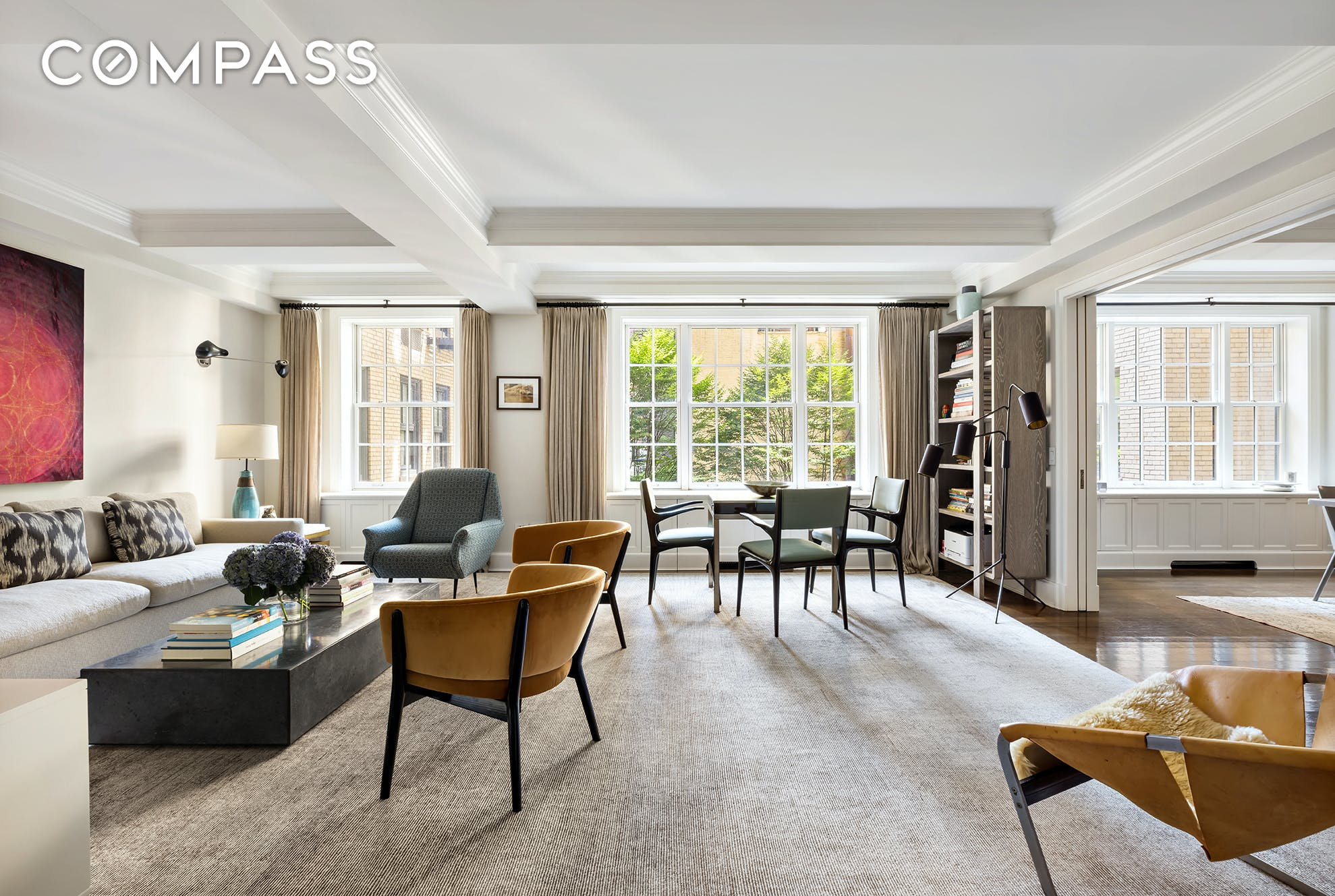 Located in a coveted full-service pre-war condominium at the center of Greenwich Village, this turn-key, 5 bedroom, 3.5 bathroom home is a perfect downtown oasis. With all the conveniences of the surrounding neighborhoods, this beautifully proportioned apartment features northern and southern exposures, hardwood floors, coffered ceilings, and top-of-the-line finishes throughout. Originally designed by Victoria Hagan, the home has many significant upgrades and is perfectly renovated.  The apartment opens to a welcoming entry foyer with a coat closet. Beyond the foyer are the entertaining rooms, which can be divided by pocket doors for privacy or opened as a 'great room' for larger gatherings or casual day to day living. The south-facing living and dining rooms overlook beautiful trees in the building's landscaped courtyard, and have ample space for multiple seating areas. The windowed kitchen features custom cabinetry and top-of-the-line appliances, including a Sub-Zero refrigerator, 48' Wolf range with griddle, and Sub-Zero wine refrigerator. The kitchen island has counter seating for three.  Opposite the entertaining rooms, the spacious primary bedroom suite features leafy views over 10th Street, a walk-in closet, and an en-suite bath with a double vanity. Down the hall, four additional bedrooms share two jack-and-jill bathrooms. One of the bedrooms is currently being used as a den/media room, but could also function as a perfect home office or guest suite. A powder room and utility closet with washer/dryer complete this home's perfect layout.  Built in 1928, Devonshire House is a pre-war condominium designed by Emery Roth and comprising 96 units over 15 stories, with interior finishes by Victoria Hagan. Amenities include a full-time doorman, live-in superintendent, fitness center, children's playroom, bike room, refrigerated storage, and a landscaped rooftop terrace. 28 East 10th Street is at the heart of everything downtown Manhattan has to offer, convenient to W
