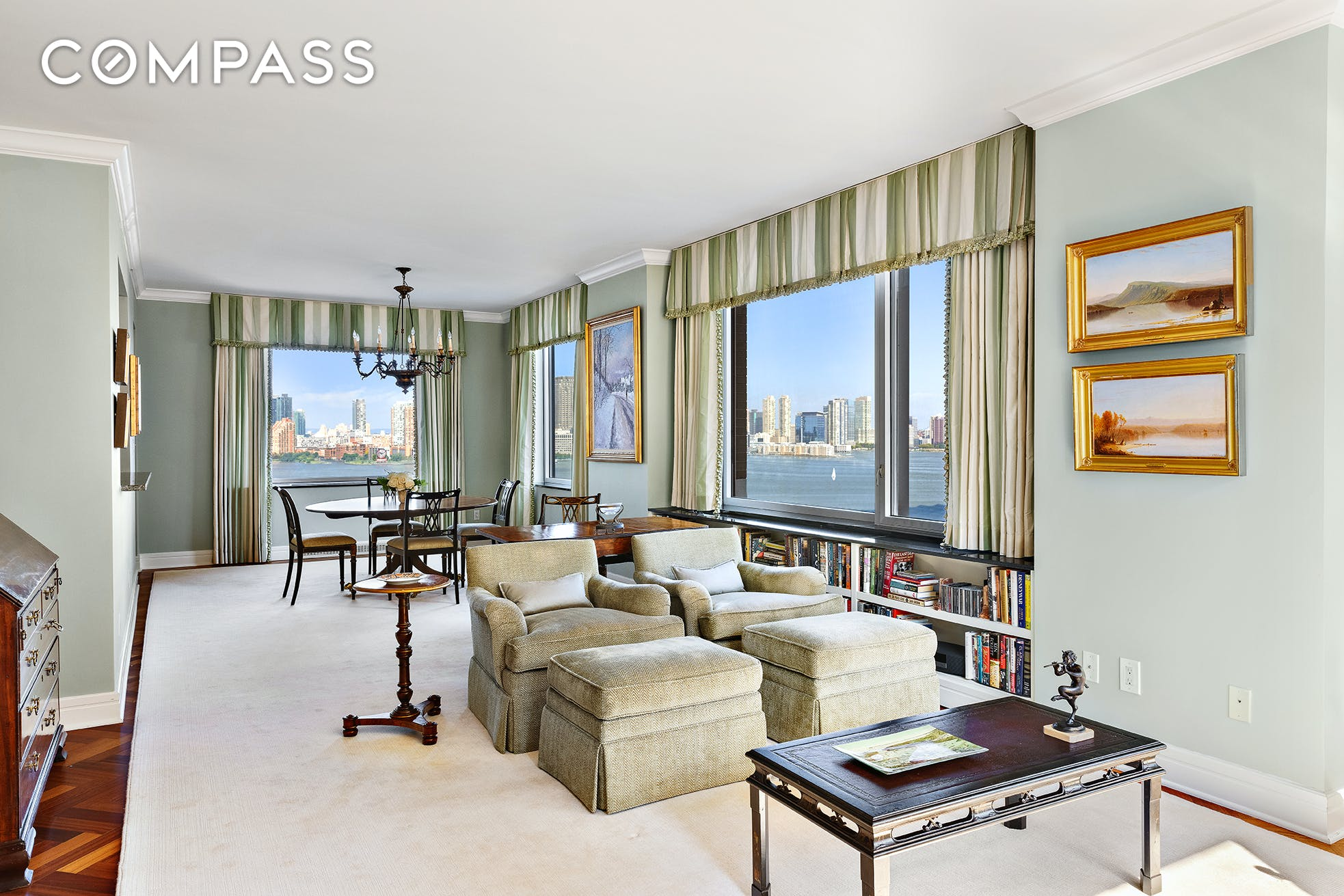 Ritz-Carlton elegance and breathtaking Hudson River views are on full display in this flawless two-bedroom, two-and-a-half-bathroom residence in desirable Battery Park City. This 1,690-square-foot home makes a dramatic first impression with a gracious foyer below a double tray ceiling. Ahead, the 35ft+ wide great room invites lavish living and entertaining surrounded by classic millwork, herringbone floors and triple-paned windows framing high-floor views to the west, north and east. From sunrise to sunset, buoyant natural light and stunning views of the downtown skyline and shimmering Hudson River become your daily backdrop. Head to the pass-through kitchen to find abundant cabinet space and upscale stainless steel appliances, including a Sub Zero refrigerator, gas cooktop, Viking wall oven, Miele dishwasher and a built-in microwave. Wake up to glorious north-facing water views in the owner's suite featuring three large custom closets and a lovely marble bathroom with a soaking tub, shower and double vanity. The split-bedroom layout places the second suite along the western exposure, where you'll find two closets, Citiquiet windows and a private bathroom featuring Scalamandr's iconic Zebras wallpaper. Double doors open the suite directly to the great room, making it ideal as a home office or study. The formal powder room includes an in-unit washer-dryer, and central HVAC ensures year-round comfort in this serene urban sanctuary. The Ritz-Carlton Battery Park condominiums offer a private, residents-only entrance combined with the revered brand's exceptional white-glove amenities. Enjoy 24-hour doorman and concierge service, gym and valet parking. Surrounded by waterfront parks and esplanades, this home puts endless outdoor space right at your doorstep. Visit Brookfield Place or Westfield World Trade Center for outstanding dining and shopping, or venture into the nearby Financial District for more world-class offerings. The 1, 4/5, R and J/Z trains and nearby CitiBik