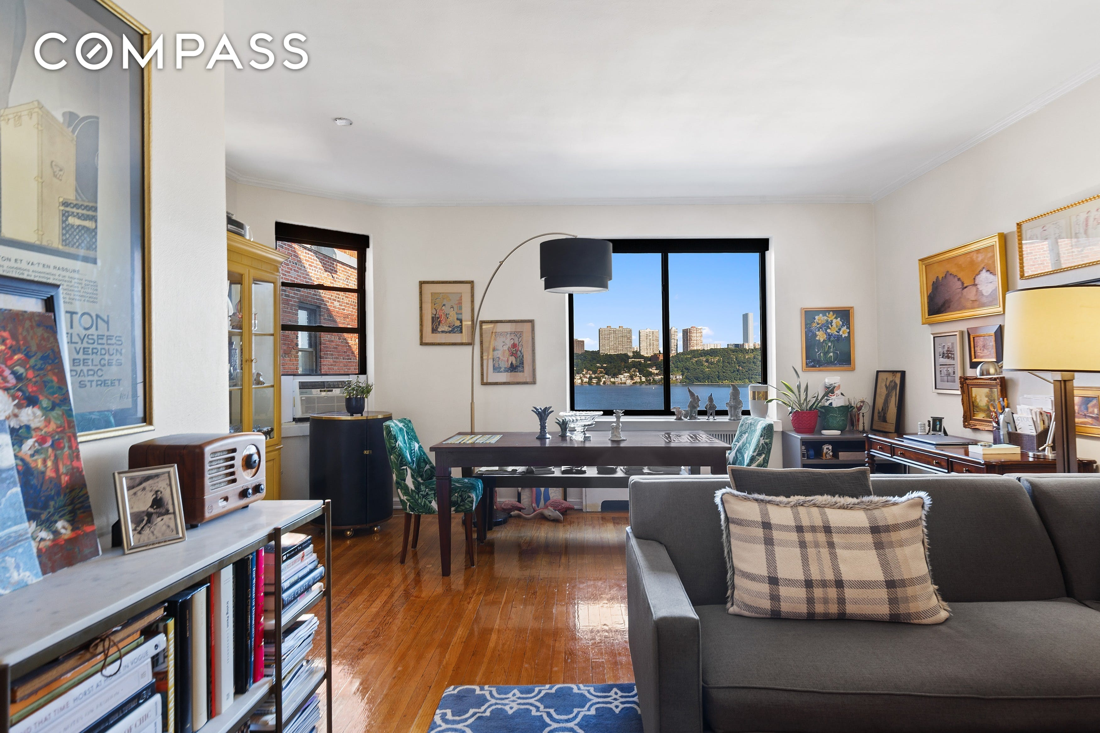 HIGH FLOOR ONE BEDROOM OVERLOOKING THE HUDSON RIVER  Space, light and open views. this large one bedroom in the esteemed River Arts has it all. Upon entering the gracious foyer, you immediately know this home is special. With direct views of the Hudson River and GWB from the living space and tranquil leafy garden views from the bedroom, this rare find offers the best of all scenarios, invigorating morning sunshine and captivating afternoon sunsets. If you long to have sophisticated dinner parties with an equally fabulous backdrop, this L-shaped living/dining space fits the bill. The king-sized bedroom is nicely removed from this entertaining/workspace, separated by a bank of 4 over-sized closets and extra-wide hallway which is the perfect place to add a Washer/Dryer or additional storage. The kitchen and bathroom offer you an opportunity to put your personal stamp on your perfect home, as evidenced by the low asking price.    Welcome to the River Arts, the premiere full-service DM building in the Audubon Triangle of Washington Heights. This divinely situated building overlooking the Hudson River is beautifully landscaped and attended by a full-time doorman. Amenities include indoor parking for only $230 per month, a gym ($50/year), bike storage ($25/bike/year), 24/7 laundry room, storage cages, a resident Super plus 3 porters, an events/party room and more. The building allows W/D in the units and one dog per shareholder apartment (with certain breed restrictions). Moments away from the #1 train plus easy access to the Henry Hudson, the GWB and all major Metropolitan roadways. This vibrant neighborhood offers wonderful local eateries, markets, coffee houses and after work hangs. Outdoor enthusiasts enjoy direct and easy access to the Hudson River Greenway, a beautiful, dedicated bikeway along the river plus Fort Washington Park just at the bottom of the hill which has been recently refurbished with volleyball courts, soccer fields, modern playgrounds, handball, tenn