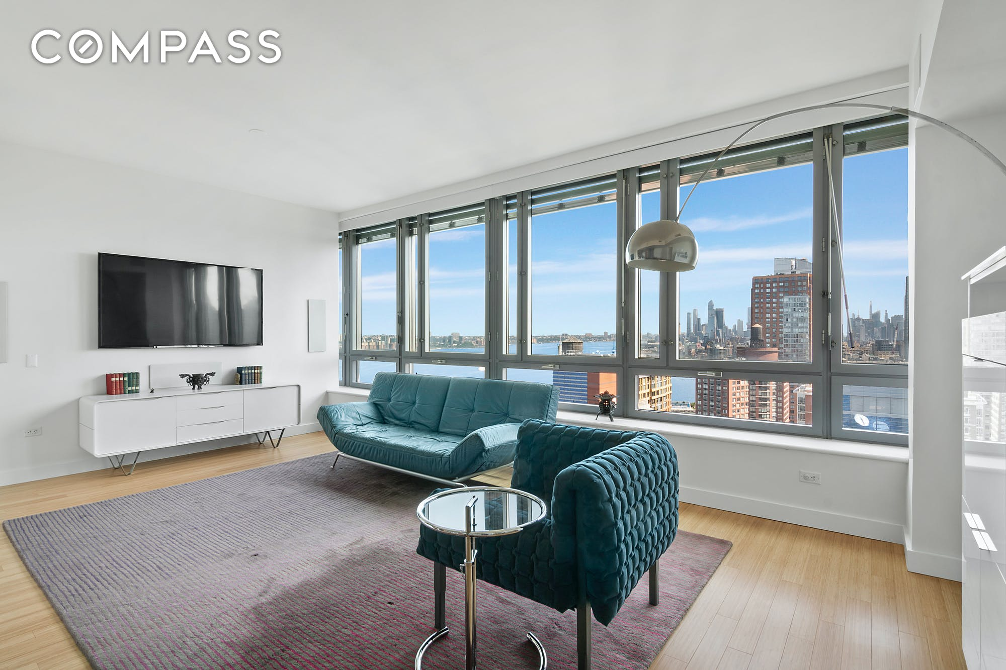 PENTHOUSE with JAW-DROPPING VIEWS at RIVERHOUSE  This expansive 1,100 square foot 1-bedroom 2-bathroom penthouse at the LEED Gold certified RIVERHOUSE is truly unmatched. The combination of open unobstructed PROTECTED views of the East River, Hudson Yards and Midtown are a rare find and some of the absolute best in New York.  On entering the apartment, you're immediately struck with the views and the amount of light streaming through the wall of windows that span across the entire length of the living room, which can only be found in the penthouse units of the building.  The impressive living room with a separate dining corner allows for flexible entertaining and dining configurations. The David Rockwell-designed kitchen includes Corian countertops, teak cabinetry, Sub-Zero and Bosch appliances and an in-suite washer and dryer. The oversized bedroom offers three closets and a four-piece bathroom with a wall of glass framing the same insane views. A second full bathroom completes this extraordinary apartment.  RIVERHOUSE is one of only a handful of LEED Gold certified condominiums in New York City where residents enjoy twice filtered air, filtered water, non-toxic materials and lower energy costs. The impressive amenities include on-site parking, gym with a yoga studio, 50' lap pool, playroom, billiards room, media cafe, and a lush second floor landscaped garden. Steps away from Rockefeller Park, Brookfield Place, Teardrop Park, Hudson River Esplanade, the Oculus, Eataly and Tribeca's culinary delights, the location offers some of the best dining and shopping options in New York.